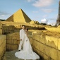China, Shenzhen, Themepark Window of the World, Wedding couple in front of Egyptian Pyramides