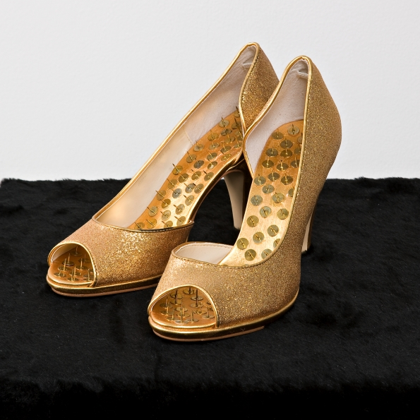 2005_Hans_Peter_Feldman_Golden_shoes_with_pins_on_velvet_2005