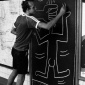 Keith_Haring_drawing_in_the_subway_circa_1981